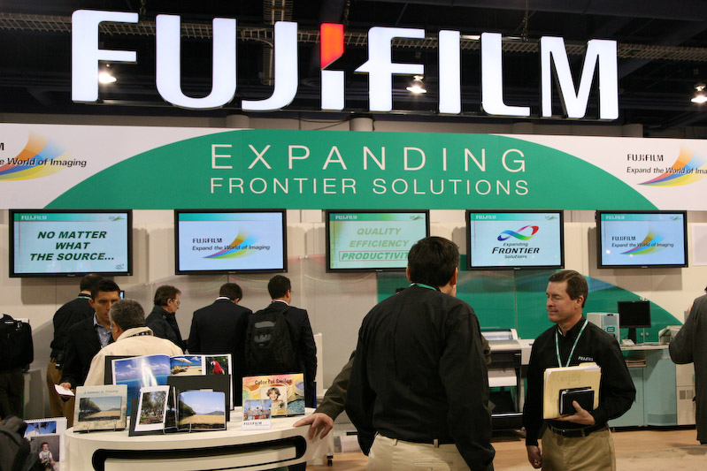 Fuji Booth Reps Discuss The Companys Frontier Lab Equipment With Prospective Customers