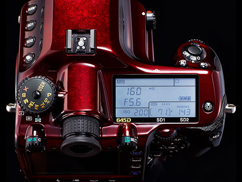 The Pentax 645D Japan has gold-plated mode dial indications, as well as a white backlight for the top-panel display. Photo provided by Pentax Imaging Co. Click for a bigger picture!