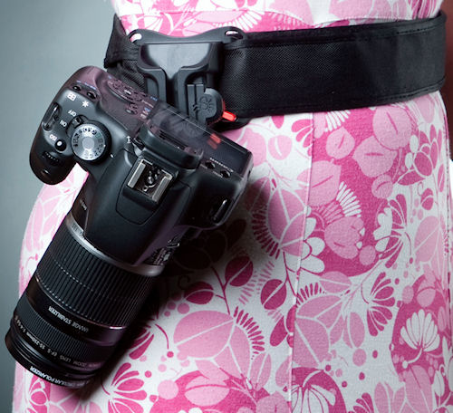 Canon digital SLR attached to the Black Widow camera holster. Photo provided by Shai Gear LLC. Click for a bigger picture!