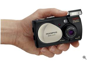 Olympus' Camedia Brio D-150 digital camera,  shown in-hand to indicate size. Courtesy of Olympus. Click for a bigger picture!