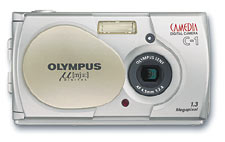 Olympus'  digital μ[mju:] Camedia C-1 digital camera, front view with lens cover open. Courtesy of Olympus Europe.