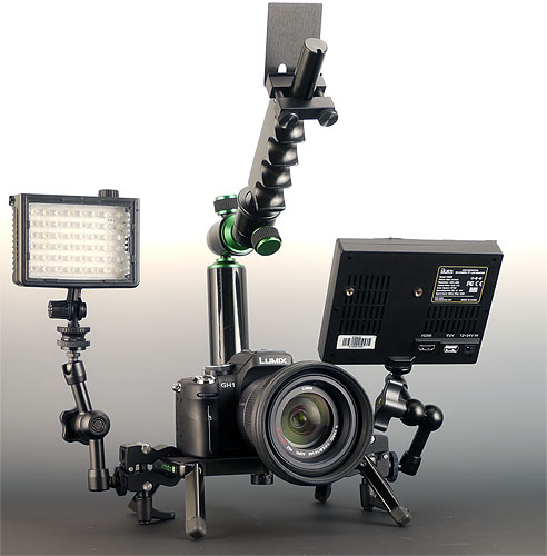The Camtrol Grand system, shown with Panasonic Lumix DMC-GH1 digital camera and 14-140mm lens mounted. Also attached are an Ikan V5600 5.6-inch HDMI LCD and an unidentified LED video light, each mounted via optional 4-inch Camtrol articulating arms. Photo provided by Camtrol LLC. Click for a bigger picture!