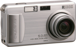 Ricoh's Caplio R2 digital camera. Courtesy of Ricoh, with modifications by Michael R. Tomkins. Click for a bigger picture!