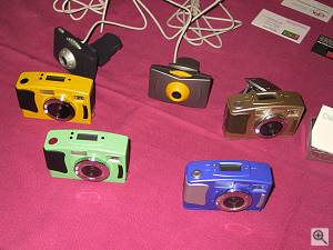 Chicony's TC800 digital camera in several colors. Copyright (c) 2000, Michael R. Tomkins, all rights reserved. Click for a bigger picture!