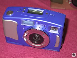 Chicony's TC800 digital camera in closeup. Copyright (c) 2000, Michael R. Tomkins, all rights reserved. Click for a bigger picture!
