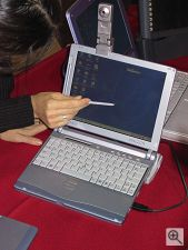 Fujitsu's LifeBook notebook computer with digital camera attached. Copyright (c) 2000, Michael R. Tomkins, all rights reserved. Click for a bigger picture!