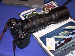 Nikon's 80-400MM Vibration Reduction lens fully extended, mounted on a Nikon D1 digital camera. Copyright (c) 2000, Michael R. Tomkins, all rights reserved. Click for a bigger picture!