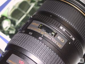 A closeup of the top of Nikon's 80-400MM VR lens. Copyright (c) 2000, Michael R. Tomkins, all rights reserved. Click for a bigger picture!
