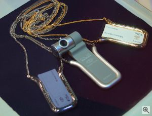 Memory Stick necklace holders and camera. Copyright © 2001, Michael R. Tomkins. All rights reserved. Click for a bigger picture!