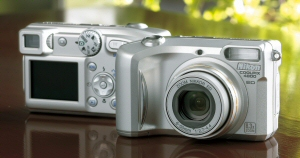 Nikon's Coolpix 4800 digital camera. Courtesy of Nikon, with modifications by Michael R. Tomkins. Click for a bigger picture!