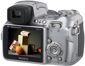 Sony's Cyber-shot DSC-H1 digital camera. Courtesy of Sony, with modifications by Michael R. Tomkins. Click for a bigger picture!