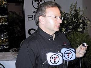 DataPlay's Steve Volk receives two awards from Tech TV for the DataPlay optical disc. Courtesy of David Kamanski / A Digital Eye.