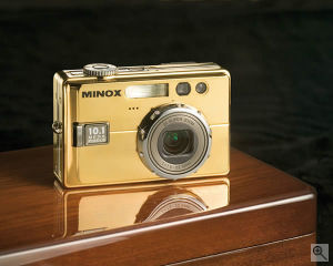 Minox's DC 1011 Carat digital camera. Courtesy of Minox, with modifications by Michael R. Tomkins. Click for a bigger picture!