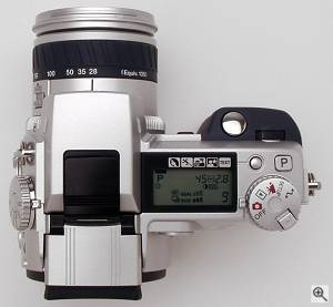 Minolta's DiMAGE 7 digital camera, top view. Copyright  (c) 2001, The Imaging Resource. All rights reserved. Click for a bigger picture!