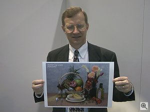 Dave Etchells holding a print from Minolta's Dimage 7 digital camera. Copyright (c) 2001, Michael R. Tomkins, all rights reserved. Click for a bigger picture!