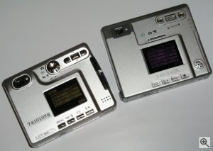 Minolta's DiMAGE Xt digital camera (prototype) alongside the existing DiMAGE Xi model. Copyright (c) 2003, Michael R. Tomkins. All rights reserved.
