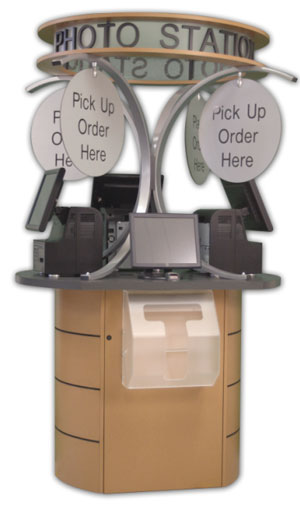 DNP Photo Imaging America's Multi-station Photo Kiosk. Courtesy of DNP Photo Imaging America, with modifications by Zig Weidelich.