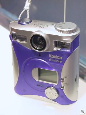 Konica's E-Mini-M digital camera, front view. Copyright (c) 2001, Michael R. Tomkins, all rights reserved. Click for a bigger picture!