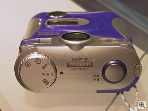 Konica's E-Mini-M digital camera, top view. Copyright (c) 2001, Michael R. Tomkins, all rights reserved. Click for a bigger picture!