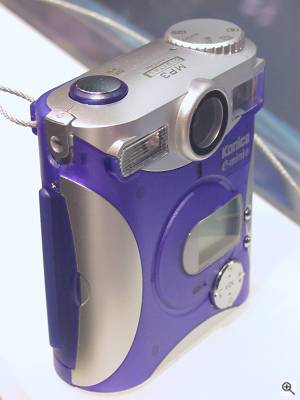 Konica's E-Mini-M digital camera, front right quarter view. Copyright (c) 2001, Michael R. Tomkins, all rights reserved. Click for a bigger picture!