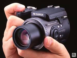 Fuji's FinePix 6900Z digital camera, shown in hand  for scale. Courtesy of Fuji. Click for a bigger picture!