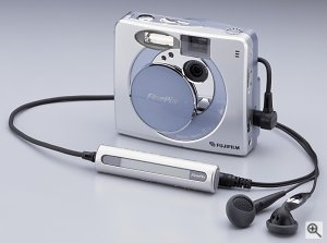 Fuji's FinePix 30i digital camera, front view with bundled headphones. Courtesy of Fuji, with modifications by Michael R. Tomkins.