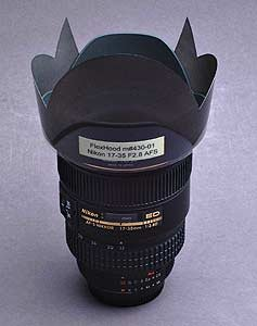 True Digital Photo's 3/4 type FlexHood model m#430-01 attached to the Nikon 17-35mm f/2.8 lens with HB-23 lens hood. Courtesy of True Digital Photo Co.