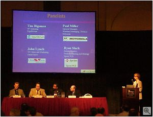 The panel discussion at the ImageScape press breakfast event. From left to right, Ryan Slack (Sprint PCS), John Lynch (OmniVision), Paul Miller (Motorola), Tim Bigoness (Equilibrium). Copyright © 2001, Michael R. Tomkins. All rights reserved. Click for a bigger picture!