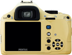 The beige version of the Pentax K-x digital SLR with 18-55mm kit lens. Photo provided by Pentax Imaging Co. Click for a bigger picture!