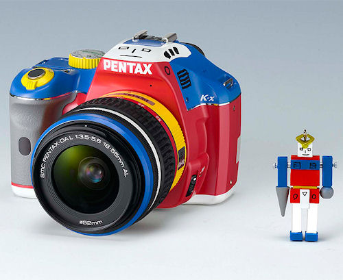 The Pentax K-x Korejanai Robot Model digital SLR with matching lens, shown alongside a Korejanai robot. Photo provided by Hoya Corp. Click for a bigger picture!