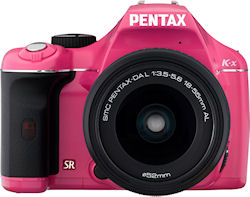 The pink version of the Pentax K-x digital SLR with 18-55mm kit lens. Photo provided by Pentax Imaging Co. Click for a bigger picture!