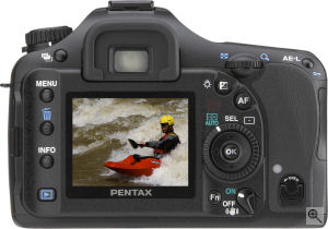 Pentax's K10D single-lens reflex digital camera. Courtesy of Pentax, with modifications by Michael R. Tomkins. Click for a bigger picture!