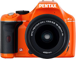 Pentax's K-x digital SLR, front view in orange body color. Photo provided by Pentax Imaging Co. Click for a bigger picture!