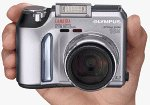 Olympus' Camedia C-730 Zoom digital camera. Courtesy of Olympus, with modifications by Michael R. Tomkins.