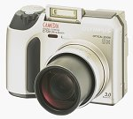 Olympus' Camedia C-720 Ultra Zoom digital camera. Courtesy of Olympus, with modifications by Michael R. Tomkins.