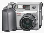Olympus' Camedia C-4000 Zoom digital camera. Courtesy of Olympus, with modifications by Michael R. Tomkins.