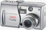 Olympus' Camedia C-60 Zoom digital camera. Courtesy of Olympus, with modifications by Michael R. Tomkins.
