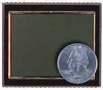 Kodak's KAF-22000CE image sensor, shown with a US quarter for scale. Courtesy of Eastman Kodak Co., with modifications by Michael R. Tomkins.