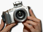 Panasonic's DMC-FZ1 digital camera. Used by permission of LetsGoDigital.nl, with modifications by Michael R. Tomkins.
