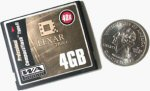 Lexar's 4GB CompactFlash card alongside a quarter for scale. Courtesy of Lexar, with modifications by Michael R. Tomkins.