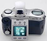 Hewlett-Packard's PhotoSmart 618 digital camera, upper rear view with LCD tilted.  Copyright (c) 2001, The Imaging Resource.  All rights reserved.
