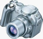 Canon's PowerShot S1 IS digital camera. Courtesy of Canon, with modifications by Michael R. Tomkins.