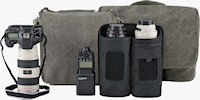 The Retrospective camera shoulder bags (background) and lens changer shoulder bags (foreground) feature tough, understated designs in either Pinestone Cotton canvas, or Black Poly Spun canvas. Photo provided by Think Tank Photo LLC.