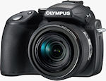 Olympus' SP-570UZ digital camera. Courtesy of Olympus, with modifications by Michael R. Tomkins.
