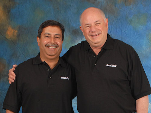 SanDisk President and COO, Sanjay Mehrotra, 52, and Chairman and CEO, Eli Harari, 65, (left to right). Today, SanDisk announced the planned retirement of Harari, who stays on with the company as chairman and CEO through the rest of 2010, and Mehrotra as President and CEO successor, effective January 1, 2011. Harari also remains an advisor with the company for two years as of January 1, 2011. Photo and caption provided by SanDisk Corp. Click for a bigger picture!