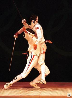 France's Hughes Obry and Switzerland's Marcel Fischer show that Olympic fencing is nothing if not dramatic! Courtesy of Sport the Library / Jason Childs / NewsDX - click for a bigger picture!