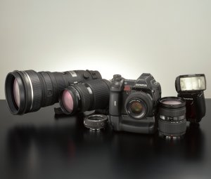Olympus' E System group of products. Courtesy of Olympus, with modifications by Michael R. Tomkins. Click for a bigger picture!