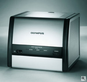 Olympus' P-11 photo printer. Courtesy of Olympus, with modifications by Michael R. Tomkins. Click for a bigger picture!