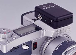 Minolta's PCT-100 Flash Adapter, shown mounted on a DiMAGE 5/7 series camera body. Courtesy of Minolta, with modifications by Michael R. Tomkins.