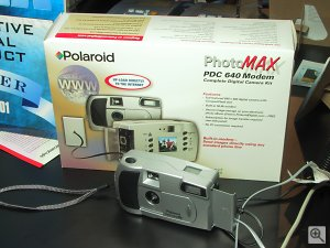 Polaroid's PDC640M digital camera shown with retail packaging behind it. Copyright (c) 2001, Michael R. Tomkins, all rights reserved. Click for a bigger picture!